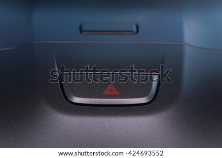 Car interior emergent warning button close up modern car - stock photo