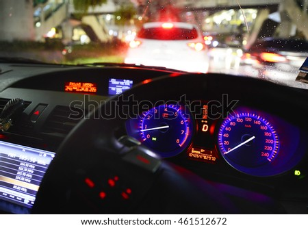 Car interior on driving. Blurred night lights