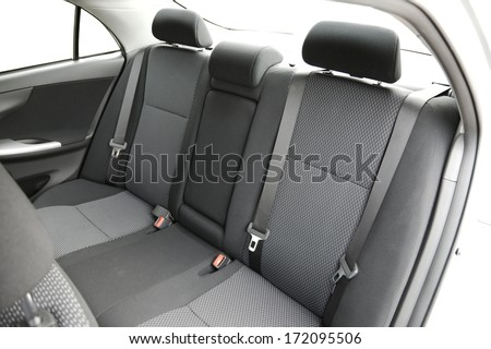 Car interior with back seats - stock photo