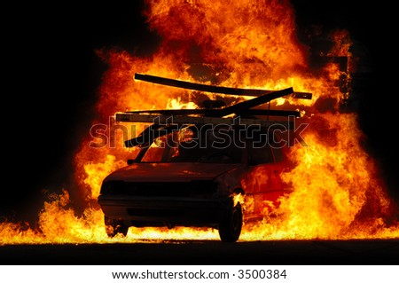 Car is driving through fire - stock photo