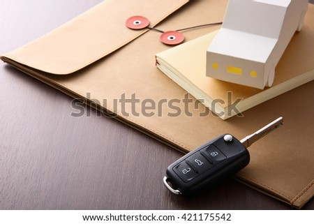 car key and book on the desk
