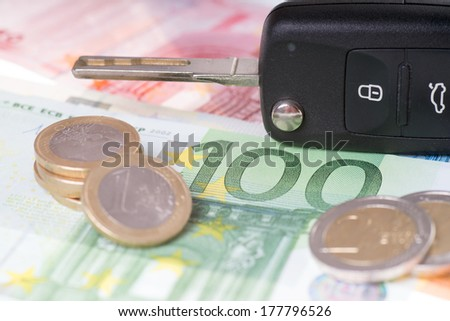 car key and euro money / Car key and money - stock photo