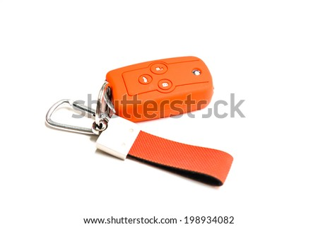 Car key and orange silicone cover  - stock photo