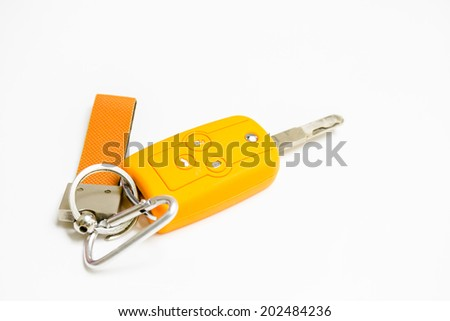 Car key and yellow silicone cover on white background  - stock photo