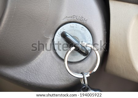 Car key at the keyhole - stock photo