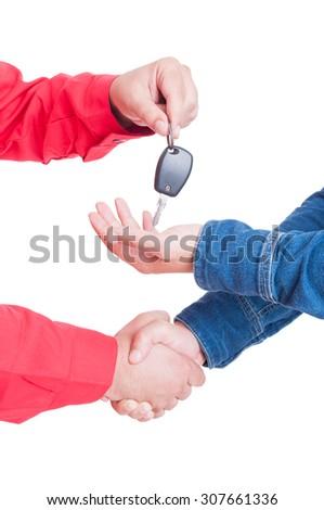 Car key handing and handshake between mechanic  and client or customer - stock photo
