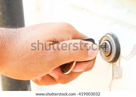 car key inserted into ignition slot and getting ready to start the car