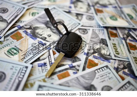 Car key on a background of dollars. Business concept - stock photo