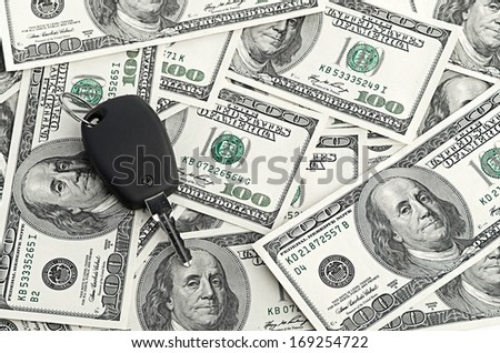 Car Key on 100 dollar background - stock photo