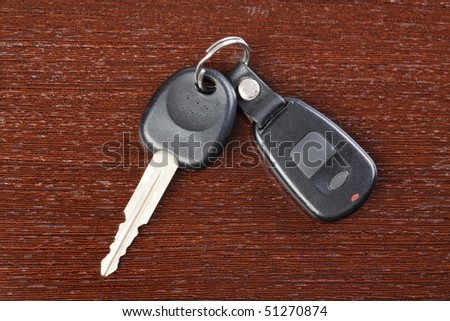 car key on wooden background