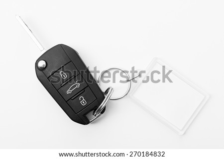 Car key with key blank for notes - stock photo