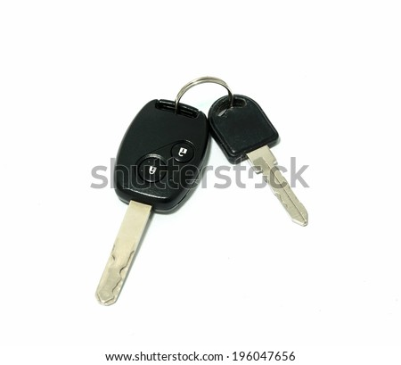 car key with remote control on white - stock photo