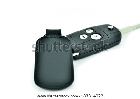 Car key with wireless remote and Leather tag on white background - stock photo