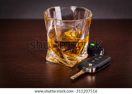 Car keys and alcoholic drink - stock photo
