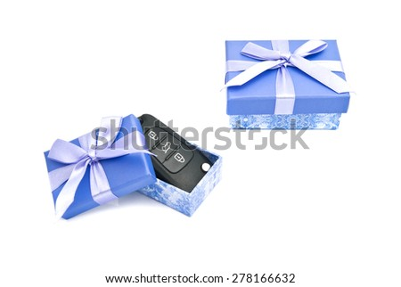 car keys and blue gift boxes on white background - stock photo