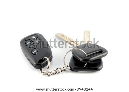 Car keys and charm from car alarm system - stock photo