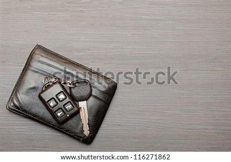 car keys and documents on dark wooden background - stock photo