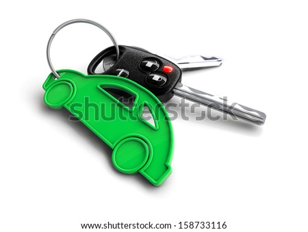 Car keys attached to a green key ring shaped like a car.  - stock photo