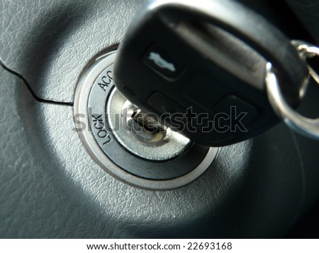 Car keys in ignition about to start the car - stock photo