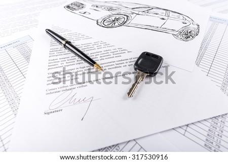 Car keys on the signed agreement document (random latin dummy text used) - stock photo