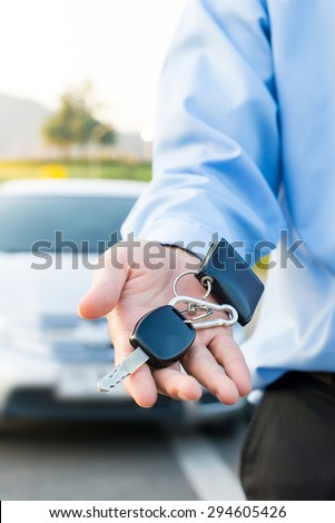 Car Keys. Seller hand giving keys - stock photo