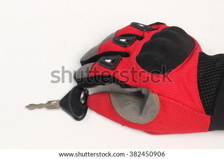 Car keys to driving gloves isolated on white background - stock photo