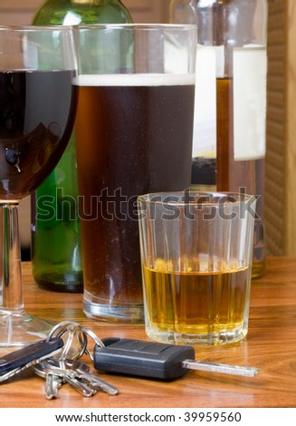car keys with wine, beer and whiskey  drink driving concept - stock photo