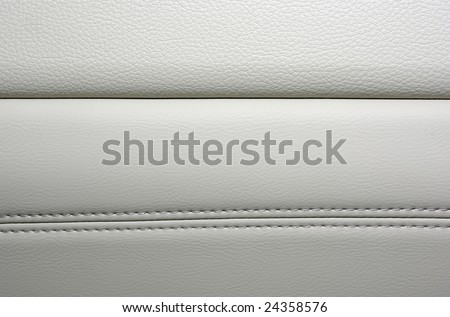 Car leather stitched interior close up white grey gray beige sofa texture background luxury covering cushion material nobody photography upholster expensive material modern cover skin closeup pattern - stock photo