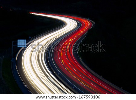 Car light in highway to the city at night. A8 in Donostia, Euskadi. - stock photo