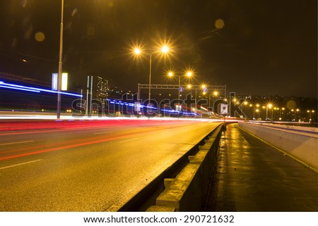 Car light streaks on a bridge over Vltava river in Prague at night