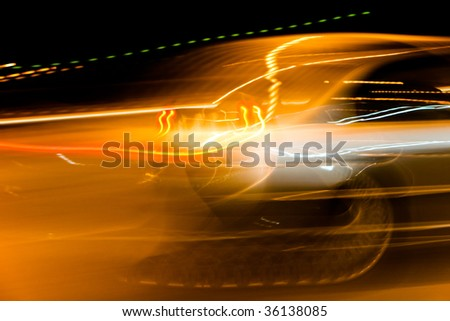 car light streaks on a city street at night - stock photo