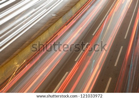 Car light trail on busy highways. - stock photo
