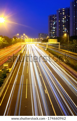 Car light trail on highway