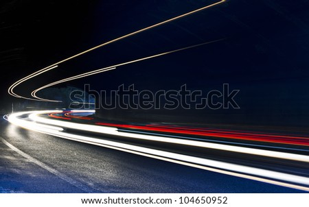 car light trails in the tunnel. Very art image . Long exposure photo taken in a tunnel below Veliko Tarnovo - stock photo