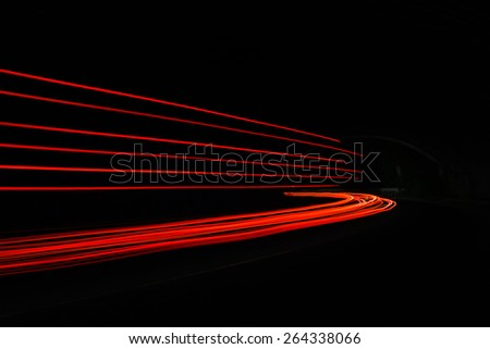 Car light trails. Long exposure photo taken in a tunnel below Veliko Tarnovo - stock photo