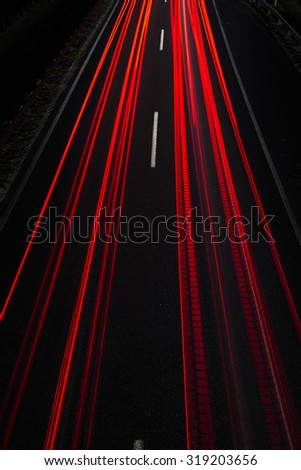 Car light trails, long exposure, top view - stock photo