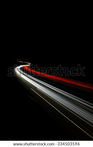 Car light trails, of traffic on the move at street, urban landscape. Art image, photo taken using long exposure at night