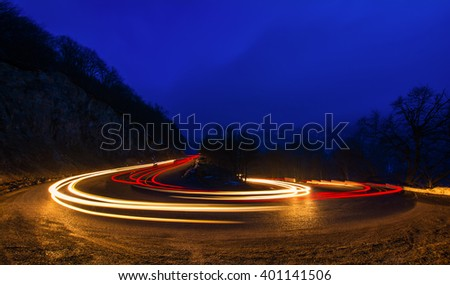 car light trails on a winding road at night in Dilijan, Armenia - stock photo