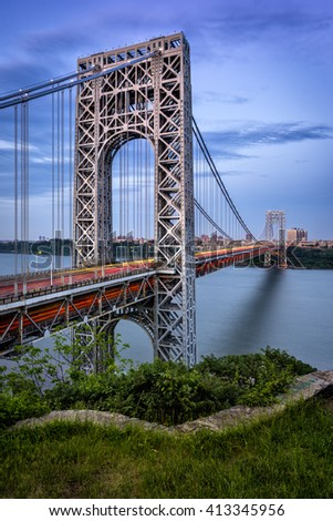 Car light trails on the George Washington Bridge at twilight. The long-span suspension bridge crosses the Hudson River, connecting Fort Lee, New Jersey and Upper Manhattan, New York City. - stock photo