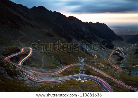Car lights by night, photo taken in Transfagarasan Romania - stock photo