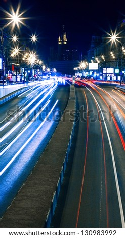 Car lights in the city - stock photo