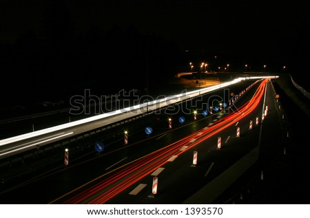 Car lights in the dark - stock photo
