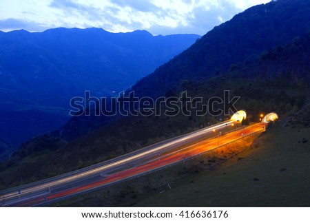 Car lights on highway at night. - stock photo
