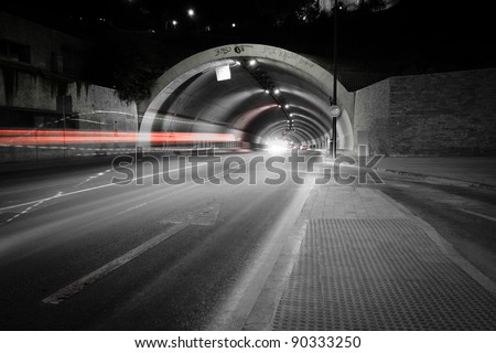 car lights trail in a tunnel in Malaga, Spain - stock photo