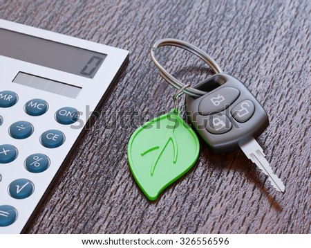Car loan calculation concept with car keys and green leaf keychain - stock photo