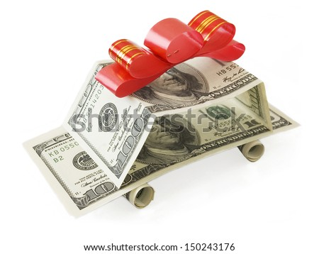 Car made from dollar and red bow isolated on white background - stock photo