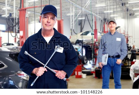 Car mechanic with wrench. Auto repair service. - stock photo