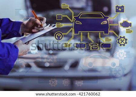 Car mechanics against close up of a man writing on a clipboard - stock photo