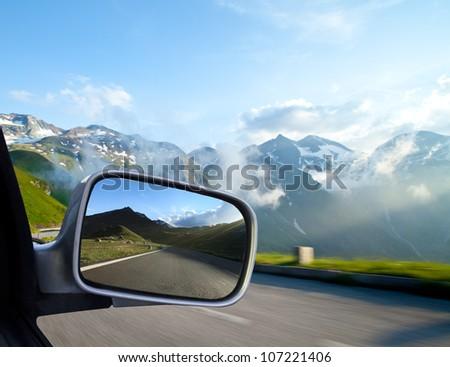 Car mirror, concept of speed - stock photo