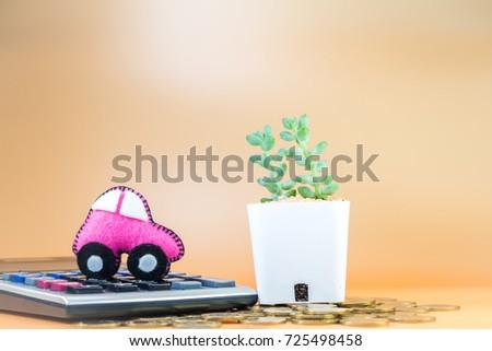 car model put on calculator coin stock photo 725498458 shutterstock